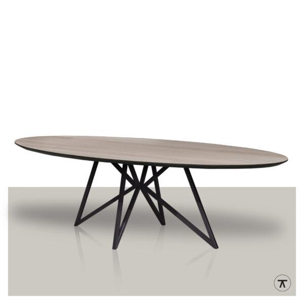 Ovale eettafel met een metalen vlinder onderstel en eikenhout blad met zwarte rand.