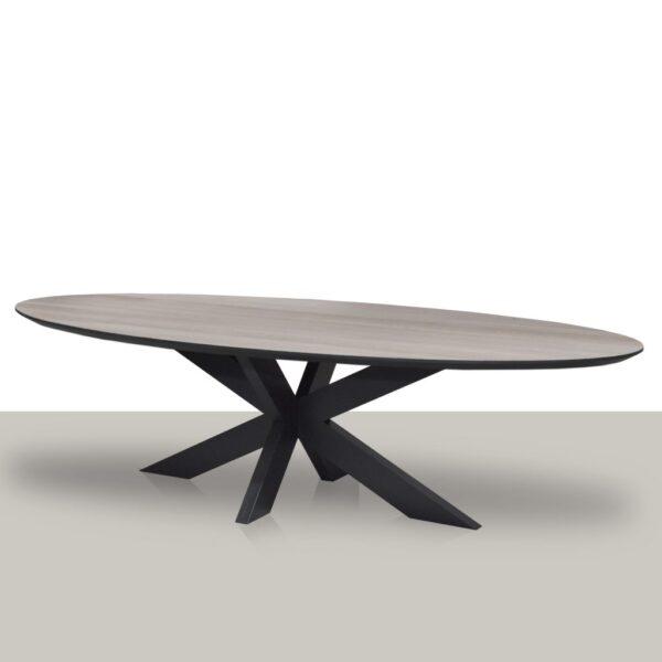 Ovale eettafel met een metalen matrix onderstel en eikenhout blad met zwarte rand Van Tafel.